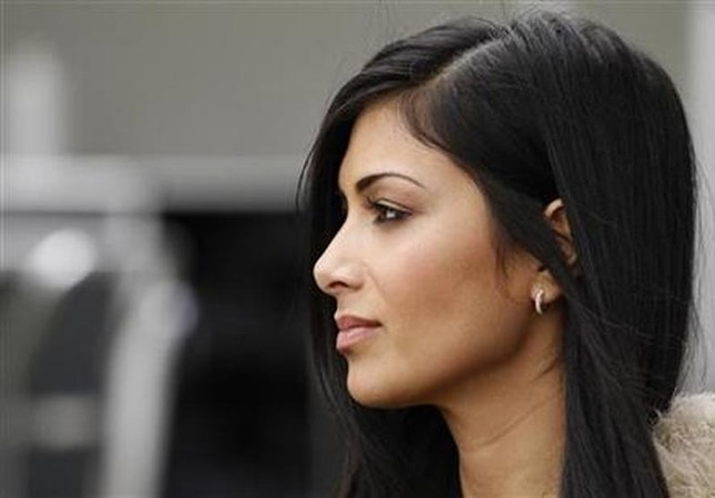 Nicole Scherzinger, girlfriend of McLaren Formula One driver Lewis Hamilton of Britain, is seen in the pits before the qualifying session of the Australian F1 Grand Prix at the Albert Park circuit in Melbourne March 26, 2011 Reuters File Photo