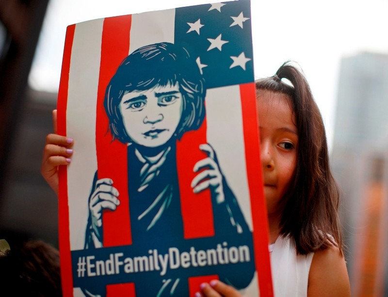 In this file photo taken on June 30, 2018 a girl takes part in a protest in Chicago against the US immigration policies separating migrant families. (AFP Photo)