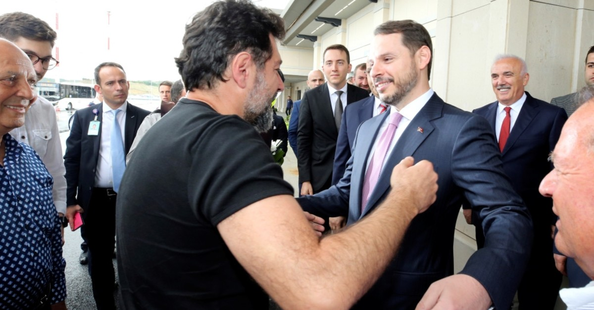 Mehmet Hakan Atilla, a former executive of state-owned Halkbank, is welcomed by Treasury and Finance Minister Berat Albayrak upon his arrival after a 28-month period incarcerated in a U.S. prison, at Istanbul Airport, July 24, 2019.