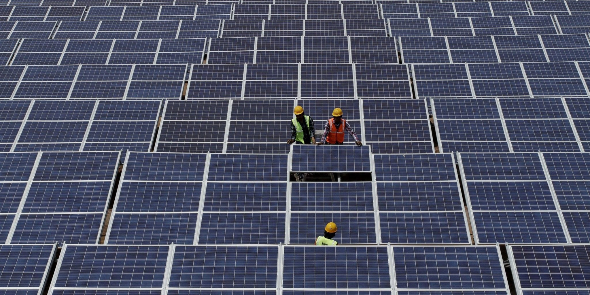 Indian workers install solar panels at the Gujarat Solar Park at Charanka in Patan district, about 250 kilometers from Ahmadabad, India, April 14, 2012. (AP Photo)