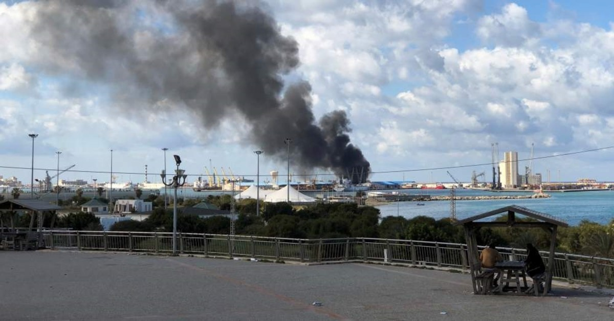 A smoke rises from a port of Tripoli after being attacked in Tripoli, Feb. 18, 2020. REUTERS
