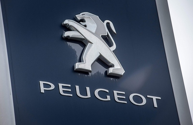 This file photo taken on February 10, 2017 shows the logo of French carmaker Peugeot in Villeneuve d'Ascq, northern France. (AFP Photo)