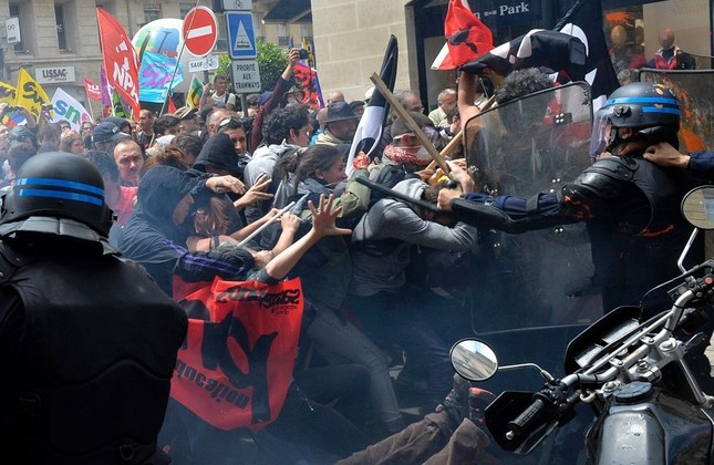 Security forces clash with demonstrators during a protest called by seven labor unions and students against the labor and employment law reform on May 26 in Bordeaux, France.