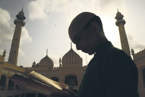 A Pakistani boy reads the Quran in Karachi.