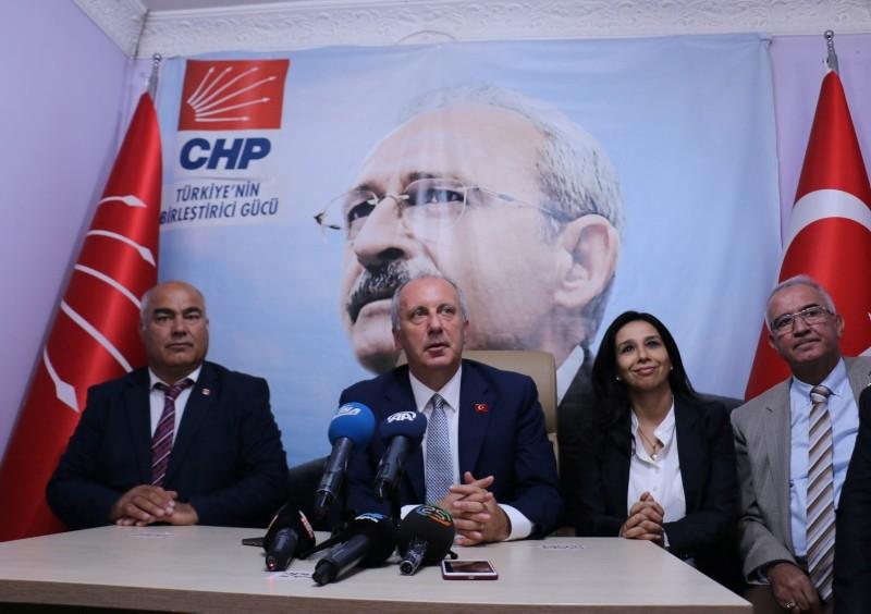 Muharrem Ince (C) speaks in front a poster of CHP Chairman Kemal Ku0131lu0131u00e7darou011flu at party's provincial headquarters in Erzurum, eastern Turkey, on July 4, 2018. (AA Photo)