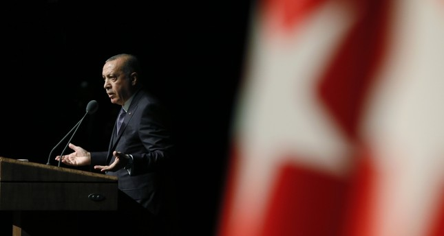 President Erdoğan speaks about the Khashoggi murder, asking some unanswered questions regarding the case in order to help find the people responsible for the killing, at a symposium in Ankara, Oct. 24.