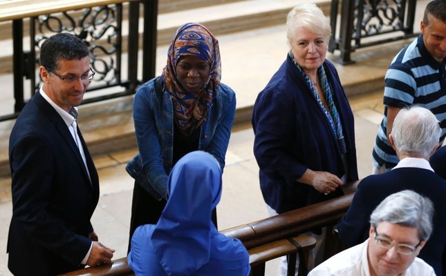 A Muslim woman shakes hands with a nun during a Mass in tribute to slain priest Jacques Hamel in the Rouen Cathedral, July 31.