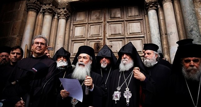 Greek Orthodox Patriarch of Jerusalem, Theophilos III, speaks during a news conference with other church leaders in front of the closed doors of the Church of the Holy Sepulchre in Jerusalem's Old City, February 25, 2018. (Reuters Photo)