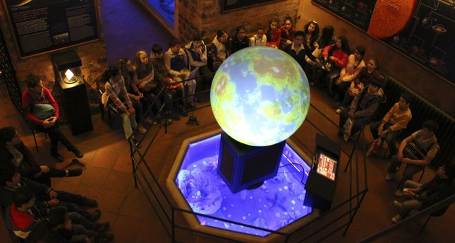 The Astronomy Workshop presents universe's 13.8 billion years of history from Big Bang to the present with videos screened on huge boards and Magic Ball. Museum experts narrate creation of stars, galaxies, celestial artifacts and solar system.