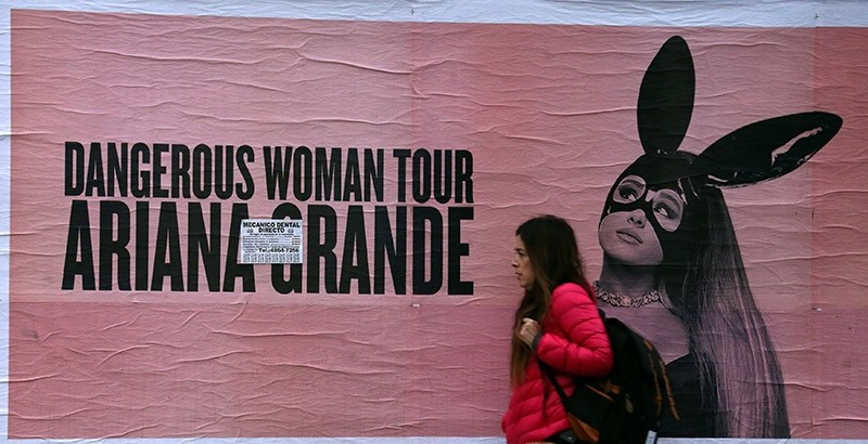 A woman walks past a billboard advertising U.S. singer Ariana Grande's world tour in Buenos Aires, Argentina May 24, 2017. (Reuters Photo)