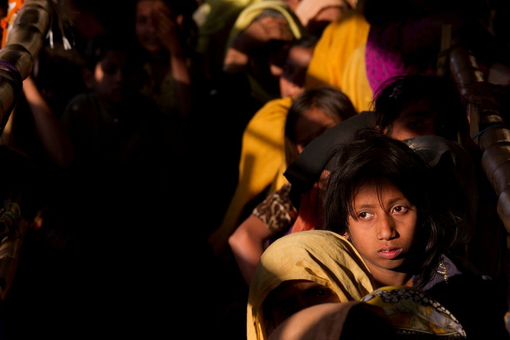 Rohingya refugees wait in a line to receive relief material at the Balukhali refugee camp near Cox's Bazar, Bangladesh, Jan. 27.