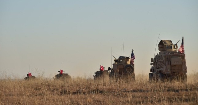 In this photo taken Thursday, Nov. 1, 2018, Turkish and U.S. troops conduct joint patrols around the Syrian town of Manbij, as part of an agreement between the two NATO allies. (Turkish Defense Ministry via AP)