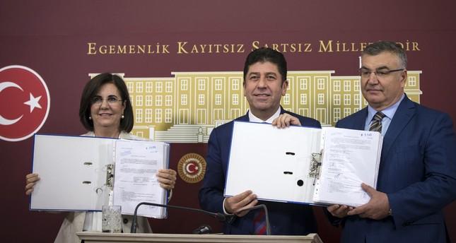CHP Party Assembly member Gaye Usluer (L) with CHP Bilecik province deputy, Yaşar Tüzün (C) and Kırklarelı Mayor Mehmet Kesimoğlu showing signatures collected for convention.