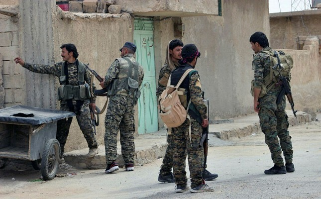 This Sunday, April 30, 2017, file photo shows militants from the SDF patrolling in the northern town of Tabqa, Syria. (AP Photo)