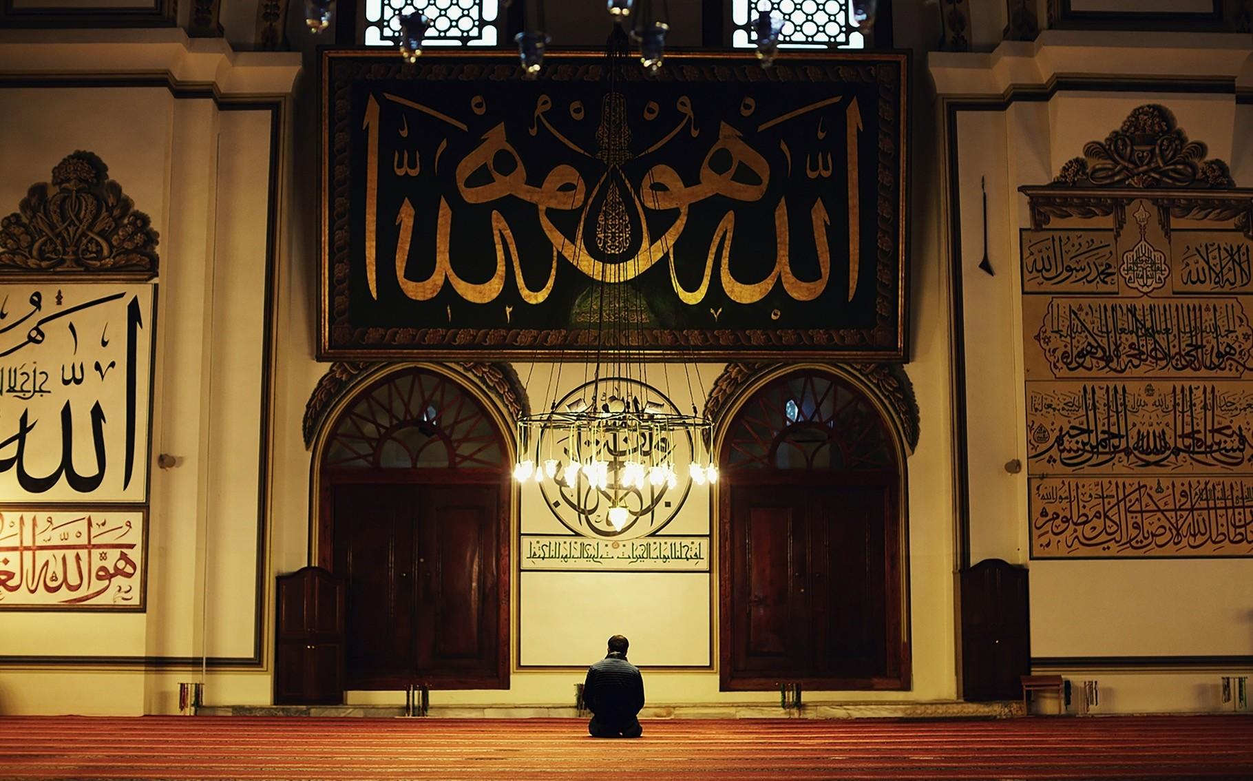 A Muslim man prays in a mosque.