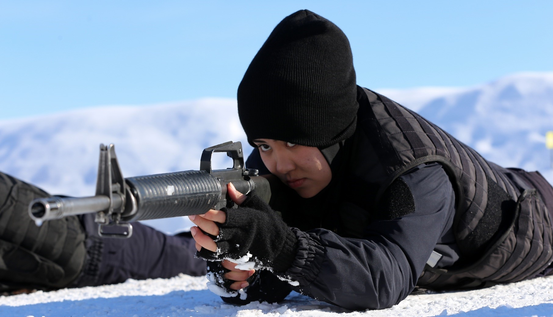 An Afghan policewoman aims her rifle during a training session in Sivas on Jan. 23, 2019.