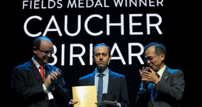 Cauchar Birkar (C), 40, receiving the Fields Medals Award, math's most prestigious prize, at the International Mathematics Convention in Rio de Janeiro, Brazil, on August 1, 2018. (AFP Photo)