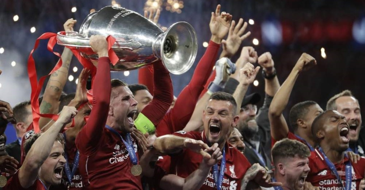 Liverpool's players celebrate with the trophy after winning the Champions League in Madrid, June 2, 2019. (AP Photo)