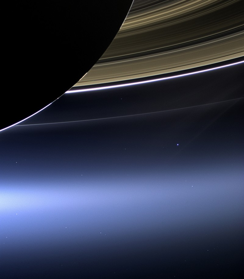 This July 19, 2013 image made available by NASA shows Saturn's rings and planet Earth, center right, as seen from the Cassini spacecraft.