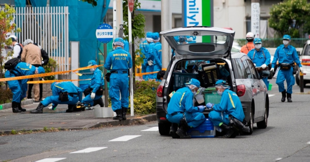 Police forensic experts work at the crime scene where a man stabbed 19 people, including children in Kawasaki on May 28, 2019. (AFP Photo)