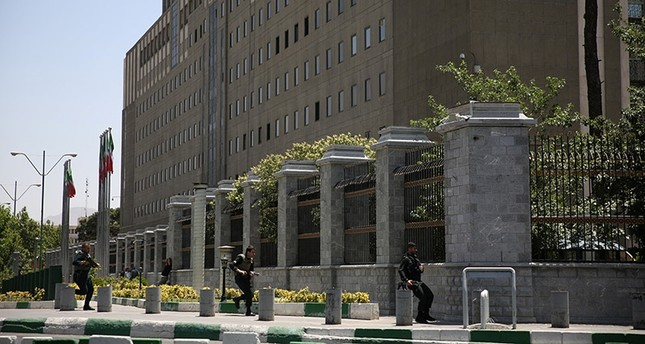 Members of Iranian forces run during a gunmen attack at the parliament's building in central Tehran, Iran, June 7, 2017. (Reuters Photo)