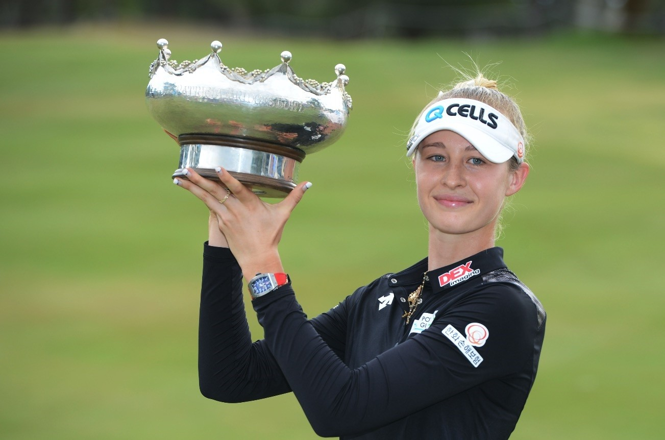 Nelly Korda poses with her trophy following  a victory at the Australian Open golf championship in Adelaide, Feb. 17, 2019.