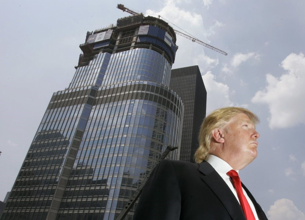 Donald Trump is profiled against his 92-story Trump International Hotel & Tower in Chicago.