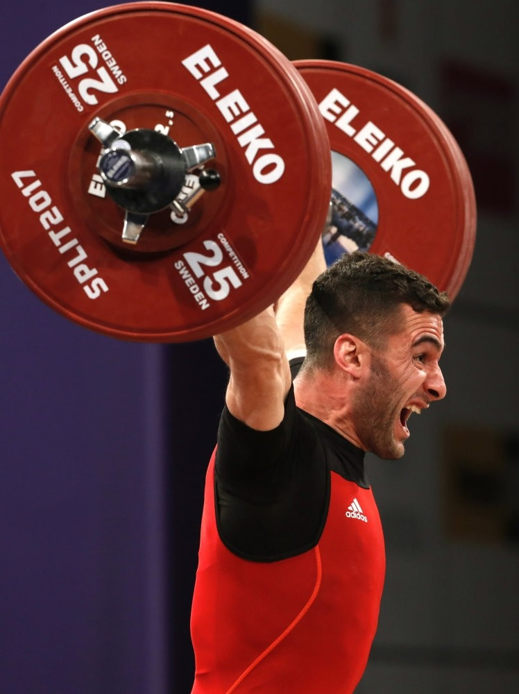 Huru015fit Atak of Turkey makes an attempt during the Men's Final 62 kilogram competition of  the Weightlifting European Championships 2017 in Split, Croatia.