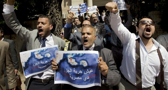 Dozens of lawyers shout slogans during a protest against the accord to hand over control of two strategic Red Sea islands, Tiran and Sanafir, to Saudi Arabia in front of the lawyers syndicate in Cairo. (AP Photo)