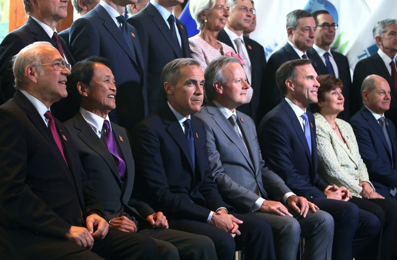 Delegates pose for an official photo at the G7 Finance Ministers Summit in Whistler, British Columbia, Canada, June 1, 2018.  (REUTERS Photo)