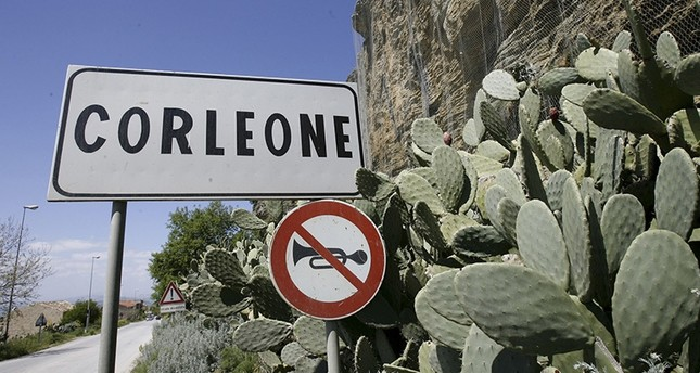 In this file photo taken on April 12, 2006, a road sign announces the town of Corleone, Italy (AP Photo)