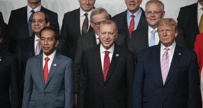 President Erdoğan poses with U.S. President Donald Trump at G20 leaders summit in Osaka, Japan, June 28, 2019.