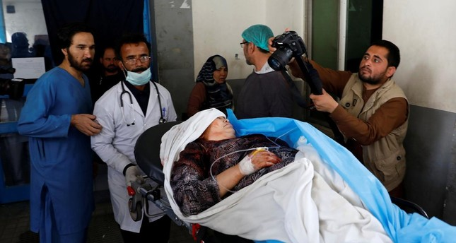 Men carry an injured woman at a hospital after a suicide attack in Kabul, Afghanistan June 11, 2018 (Reuters Photo)