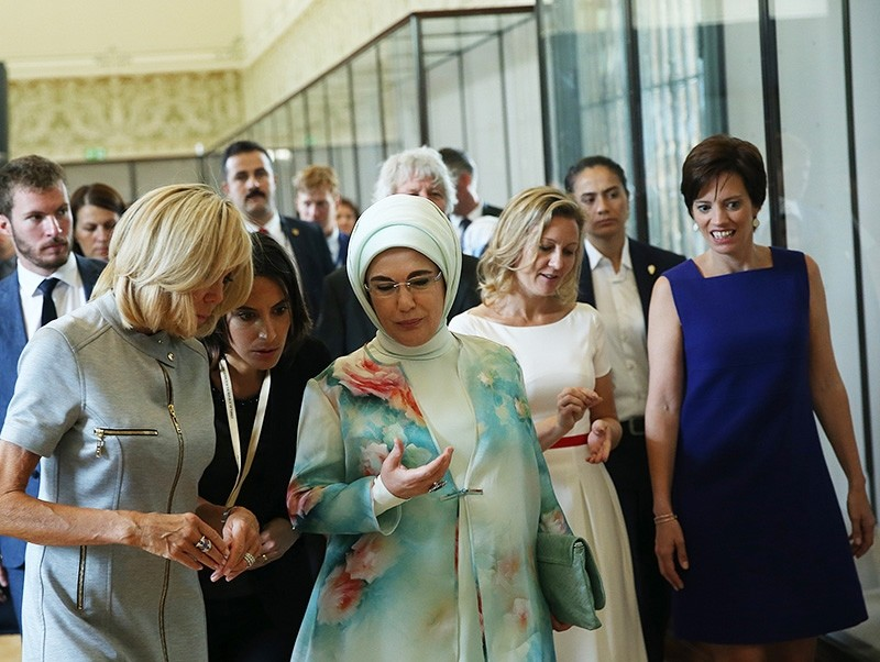 First lady Emine Erdogan (C) chats with French counterpart Brigette Macron at the Royal Museum for Central Africa in Tervuren, near Brussels, on July 12, 2018, on the sidelines of the NATO summit. (AA Photo)