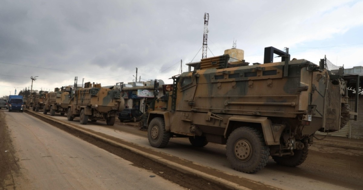 A Turkish military convoy that crossed from the border with Syria, passes through the Syrian opposition-held town of Hazano in Idlib's northern countryside, on February 22, 2020. (AFP Photo)