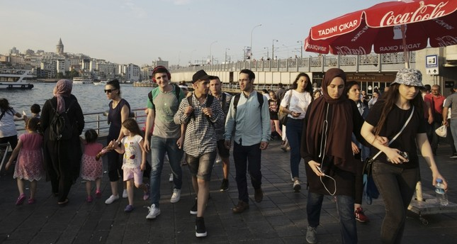 People walk near the Golden Horn in Istanbul ahead of the June 23 rerun of the Istanbul mayoral elections, June 20, 2019.