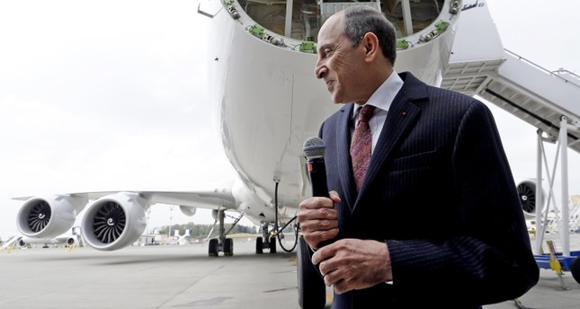 Qatar Airways CEO Akbar al-Baker finishes remarks front of a new Boeing 747-8 freighter.