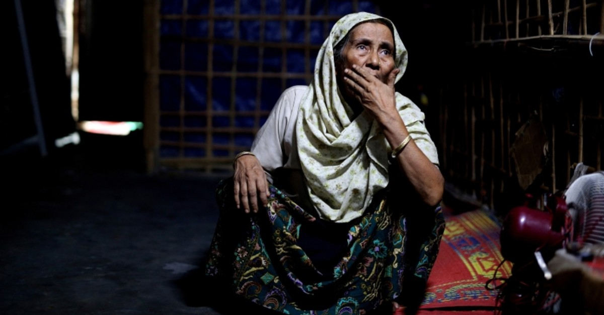 In this photograph taken Aug. 28, 2018, an elderly Rohingya refugee Noor Aisha Khatun, who used to visit spiritual healers, sits inside the family shelter in Kutupalong refugee camp, Bangladesh. (AP Photo)