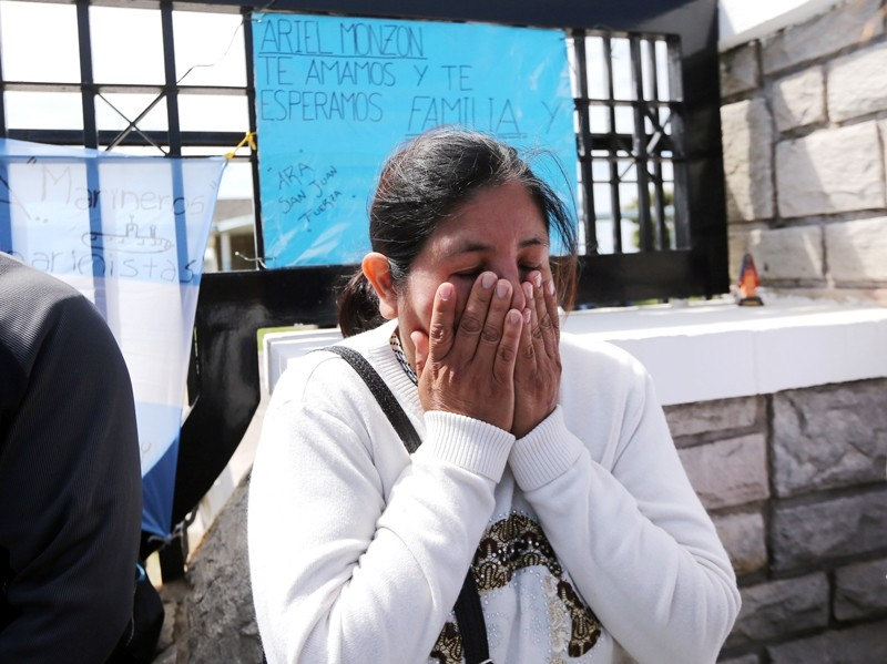 Elena Alfaro, sister of Cristian Ibanez, one of the 44 crew members of the missing at sea ARA San Juan submarine, reacts outside an Argentine naval base in Mar del Plata, Argentina (Reuters Photo)