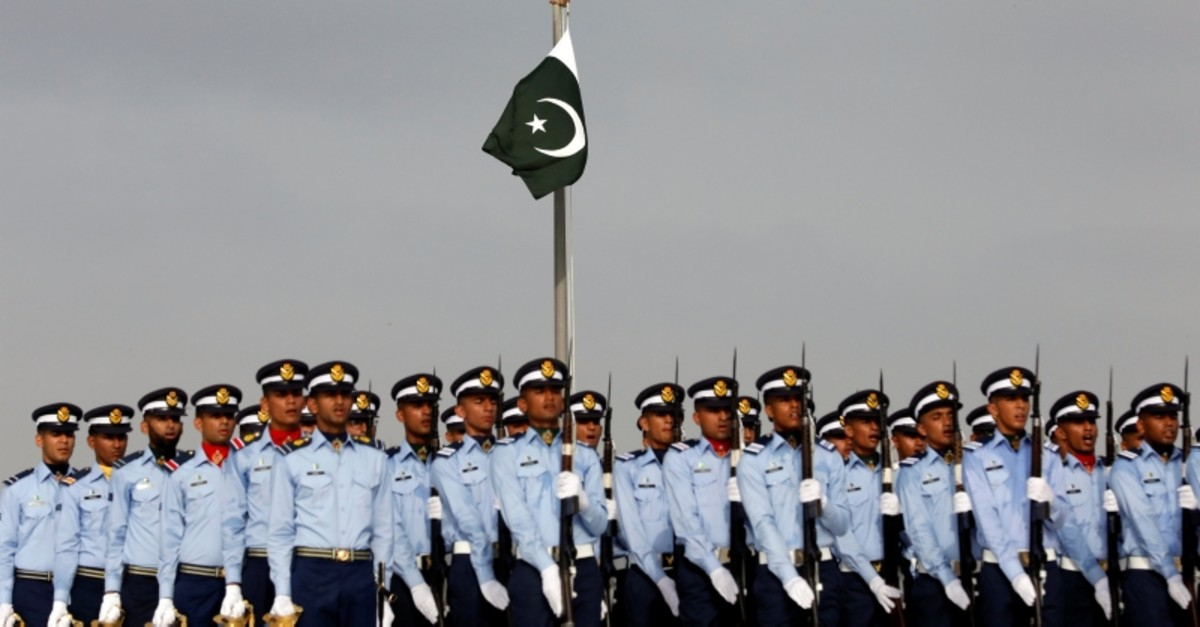 A Pakistan's national flag flies on mast as the members of the Pakistan Air Force march during Defence Day ceremonies, or Pakistan's Memorial Day, to express solidarity with the people of Kashmir, in Karachi, Sept. 6, 2019. (Reuters Photo)