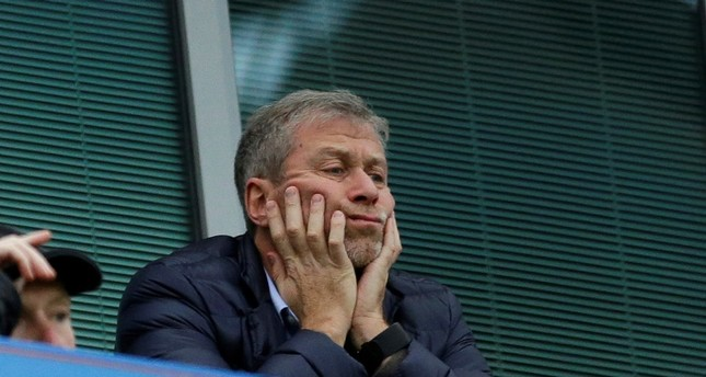 Chelsea soccer club owner Roman Abramovich sits in his box before the English Premier League soccer match between Chelsea and Sunderland at Stamford Bridge stadium in London. (AP Photo)