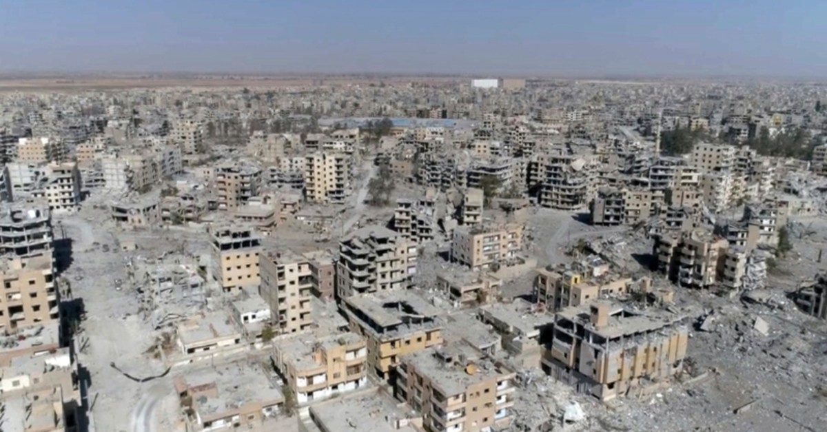 This Oct. 19, 2017 file photo, a frame grab made from drone video shows damaged buildings in Raqqa, Syria. (AP Photo)