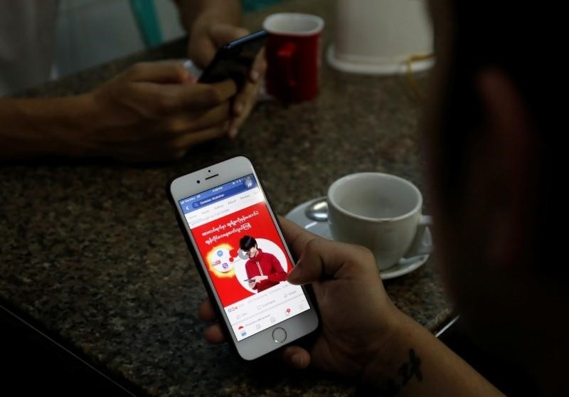 A cellphone user looks at a Facebook page at a shop in Latha street, Yangon, Myanmar August 8, 2018. (REUTERS Photo)