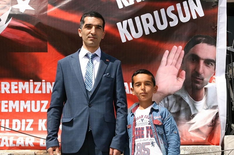 u00c7etin Yu0131ldu0131z (L) poses during the ceremony held in front his house in Konya province. (IHA Photo)