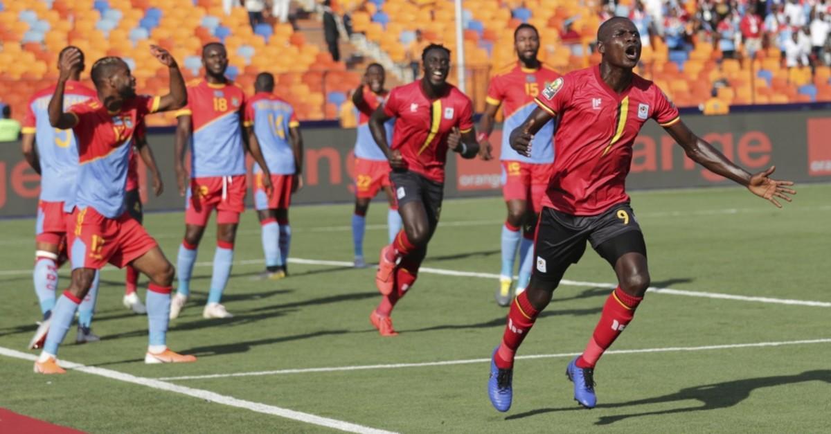 Uganda's Patrick Henry Kaddu (R) celebrates after scoring his side's opening goal against DR Congo, June 22, 2019.