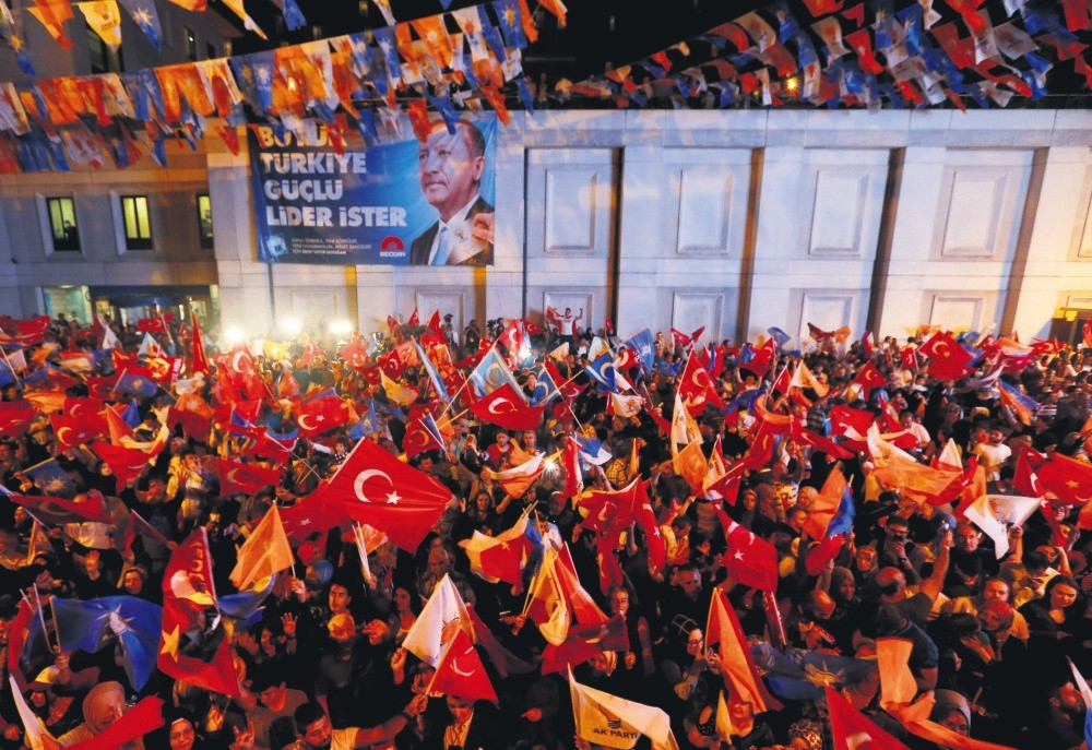 Supporters of the AK Party celebrate the election results, Istanbul, Sunday.