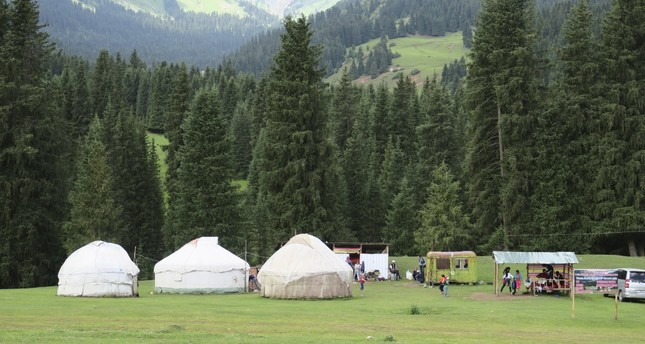 Nomads erect their tents at the Seven Bulls Valley of Kyrgyzstan.