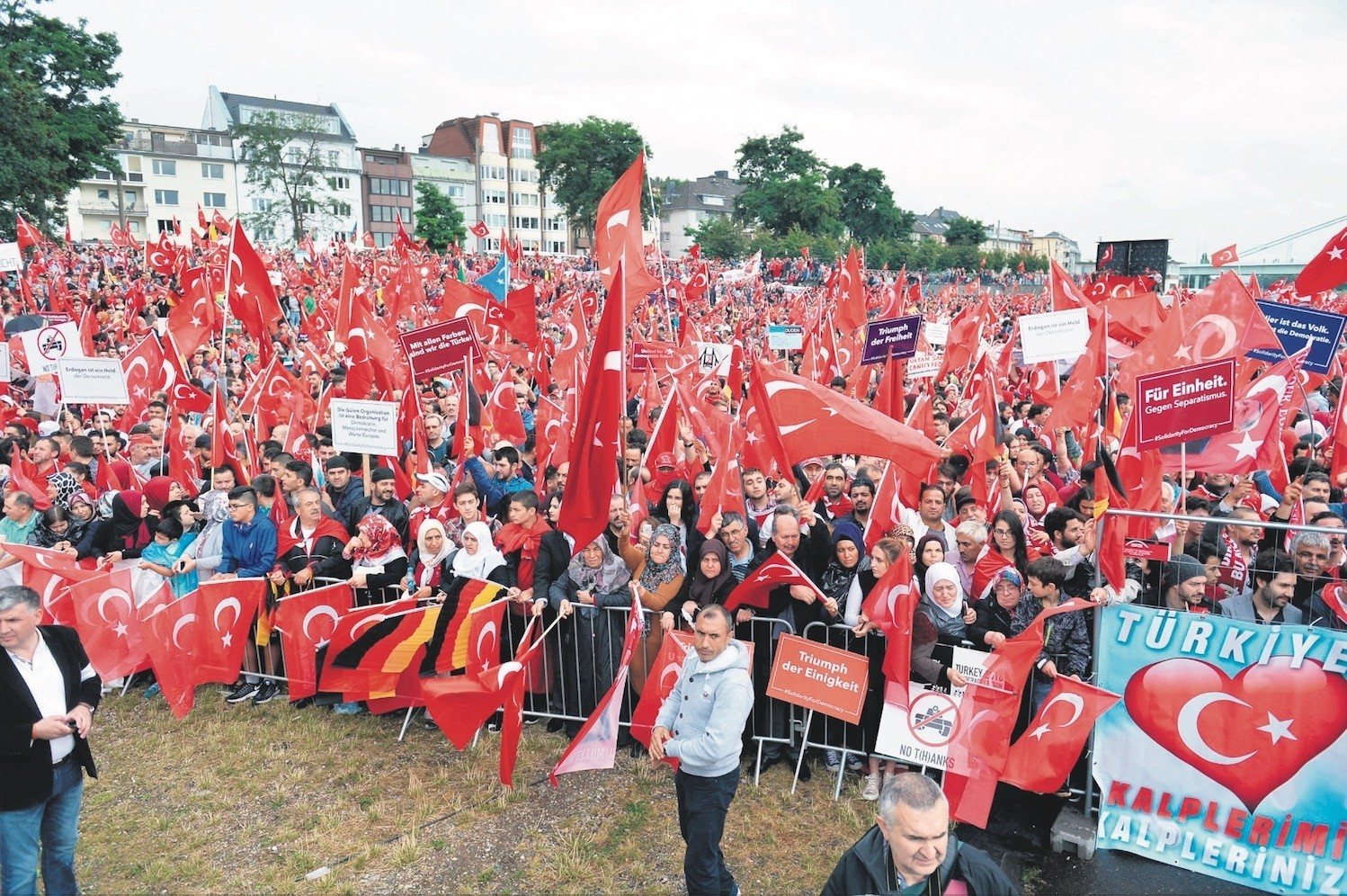 Turks attend a democracy rally in Germanyu2019s Cologne in August 2016 to protest the coup attempt by FETu00d6. Hundreds of FETu00d6 members sought asylum in Germany after the attempt.