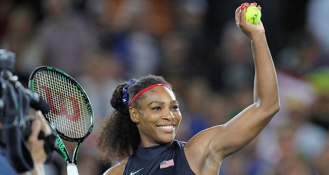 Serena Williams prepares to hit an autographed ball into the crowd at the 2016 Summer Olympics in Rio de Janeiro, Brazil. (AP Photo)
