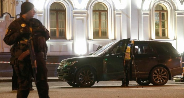 An investigator inspects a car at a site of a murder attempt on the lawmaker of the Kiev regional council and businessman Viacheslav Soboliev in Kiev, Ukraine Dec. 1, 2019.  (Reuters Photo)